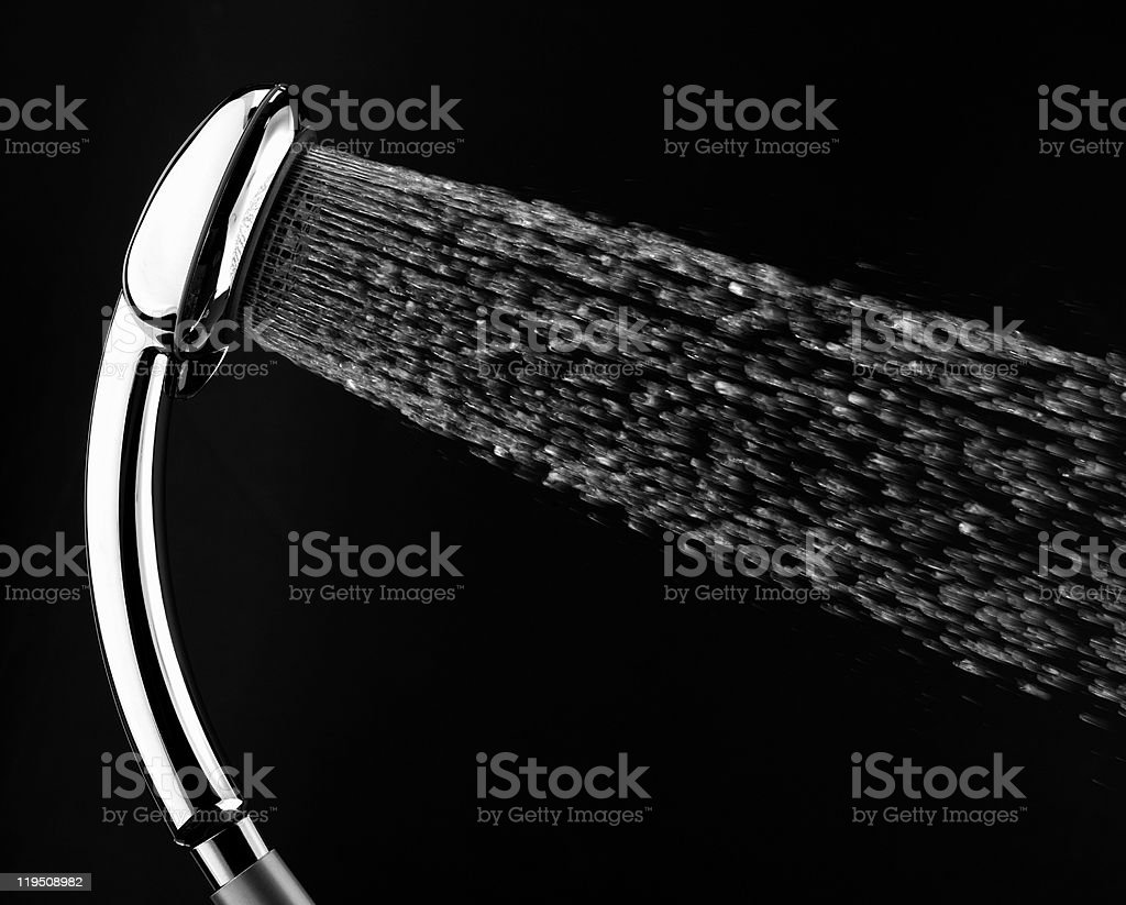 Shower head is spraying water. stock photo
