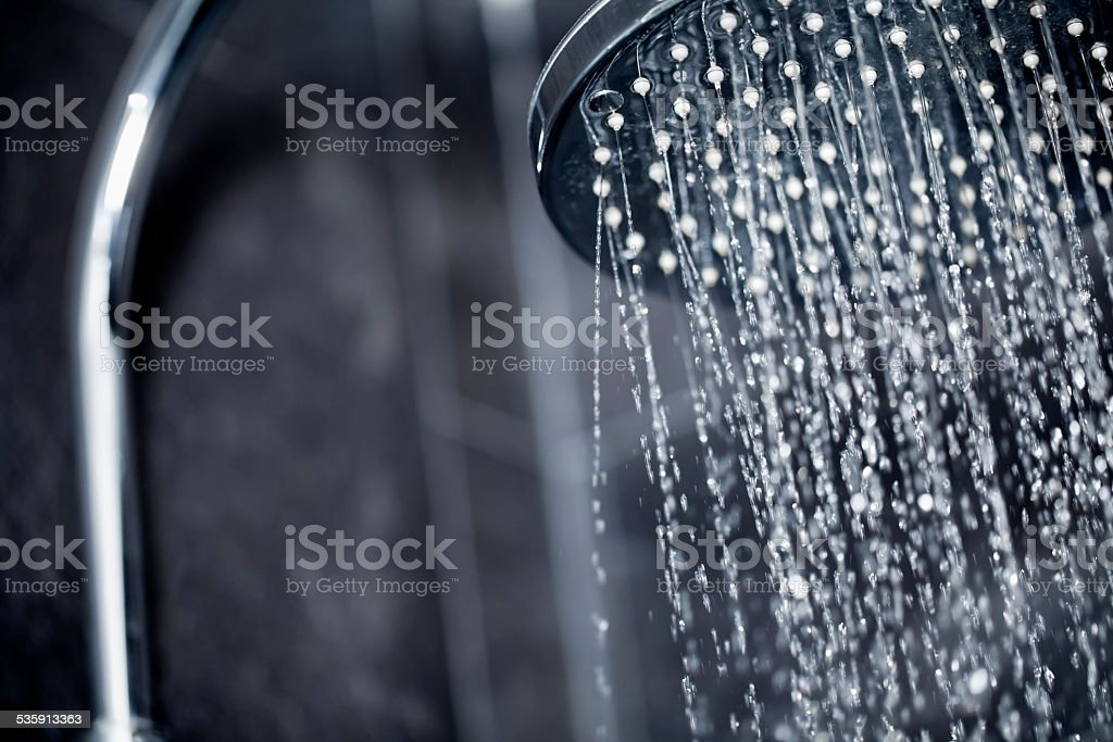 Shower head sprinkling water stock photo