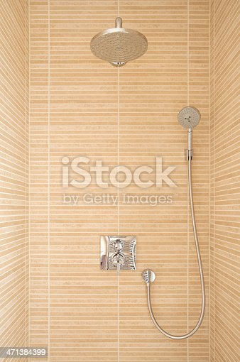 a marble tile lined shower area in a modern new home. A large