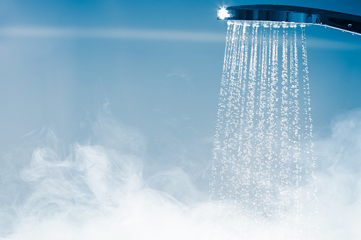 shower with flowing water and steam