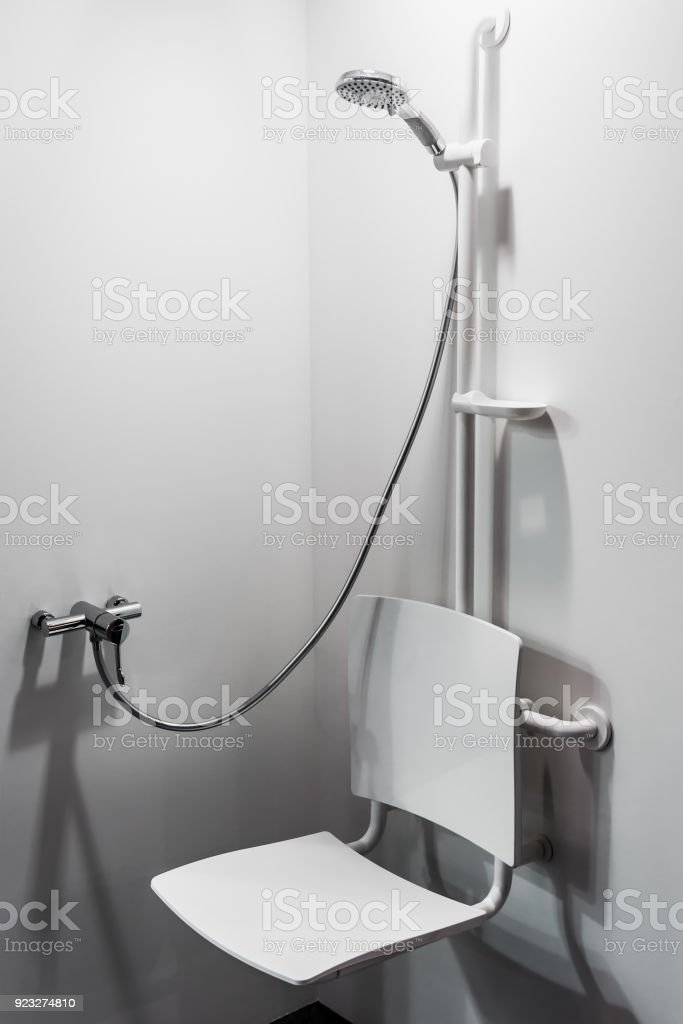 shower with seat and grab bars for disabled and elderly people stock photo