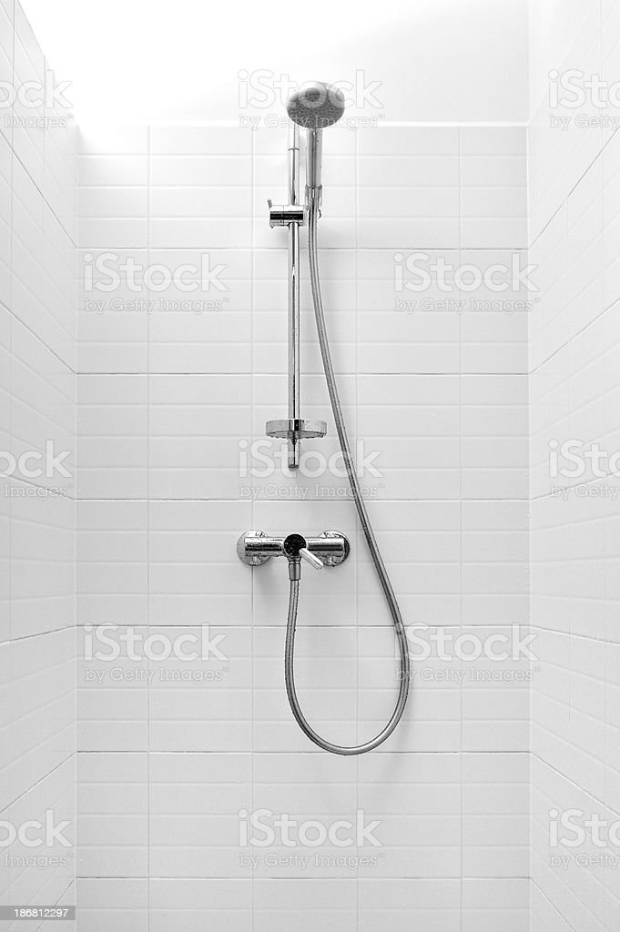 Shower with white tiles and chrome fittings stock photo