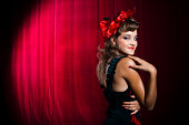 istock Showgirl Acting Coy on Stage 108176513
