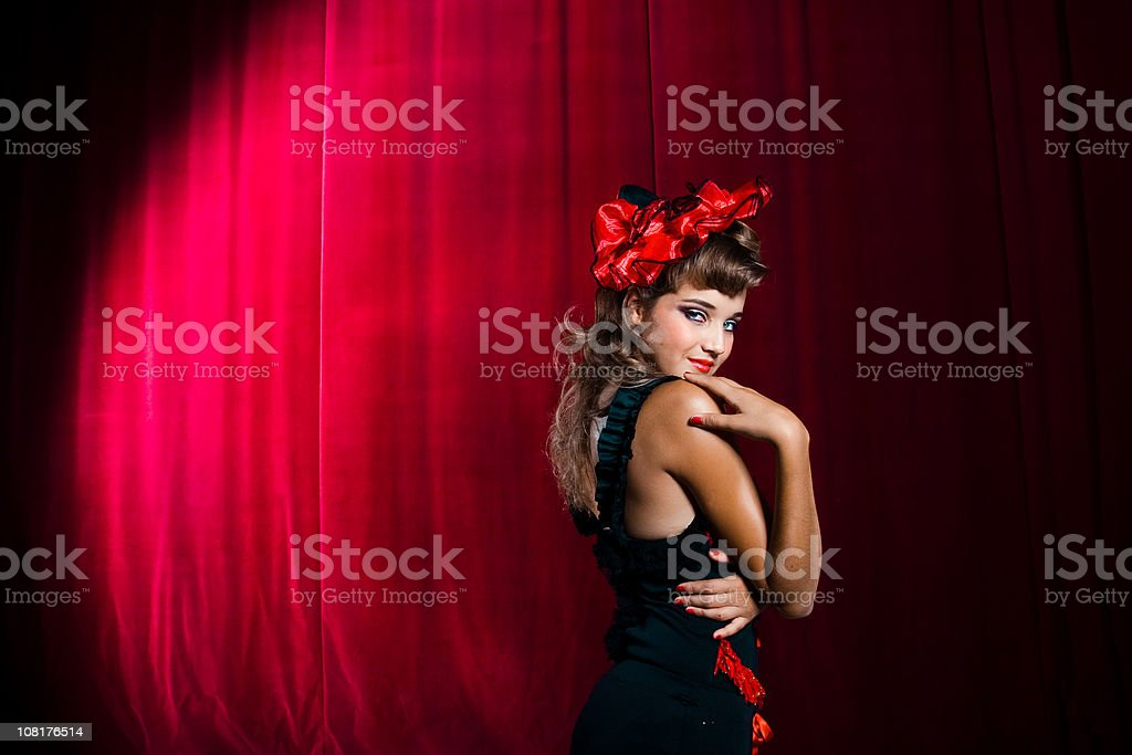 Showgirl Acting Coy on Stage stock photo