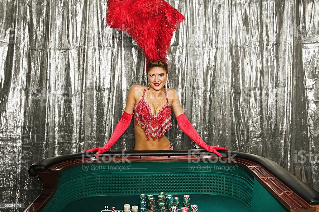 Showgirl at a craps table stock photo