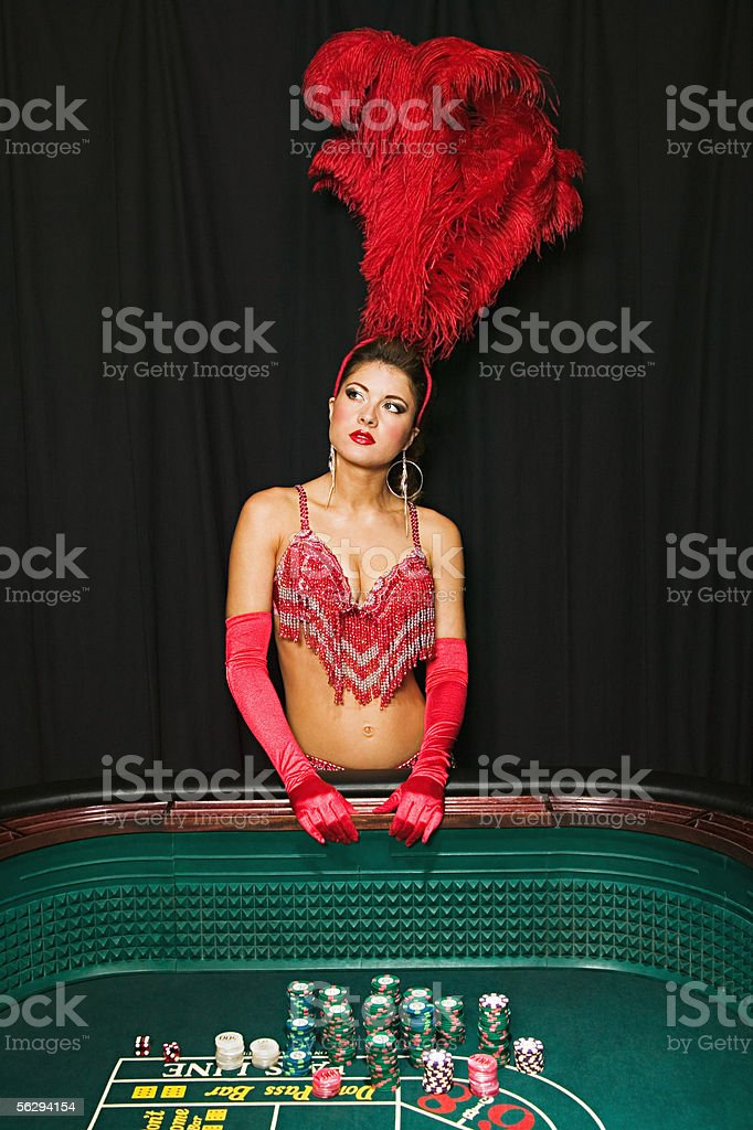 Showgirl daydreaming at craps table stock photo