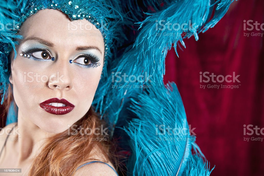 Showgirl in Blue Looking to the Side stock photo