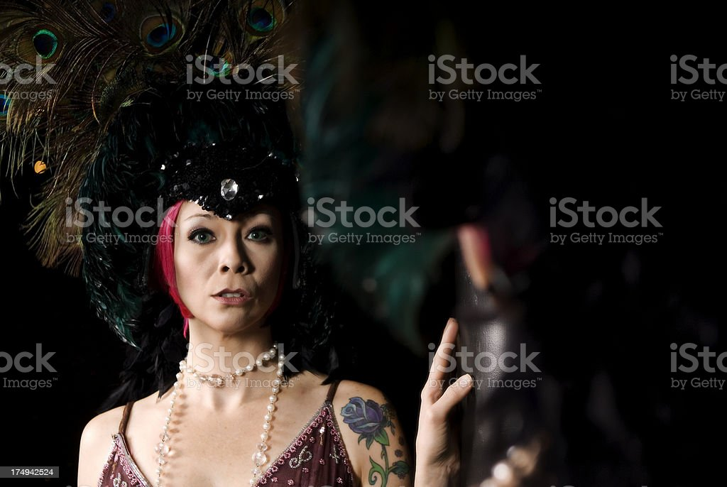 Showgirl Looking In Mirror stock photo