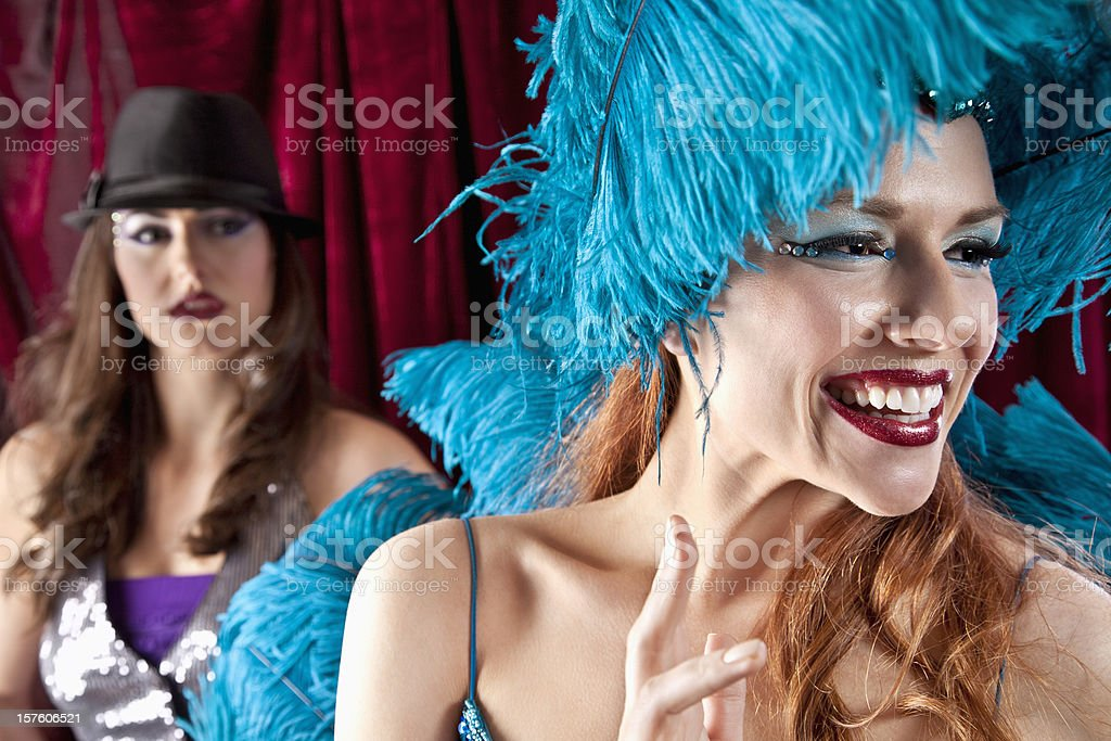Showgirl Performing with Jealous Girl Looking On royalty-free stock photo