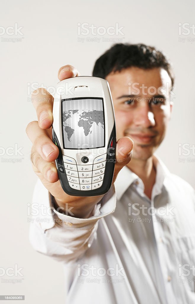 Showing a mobile phone royalty-free stock photo