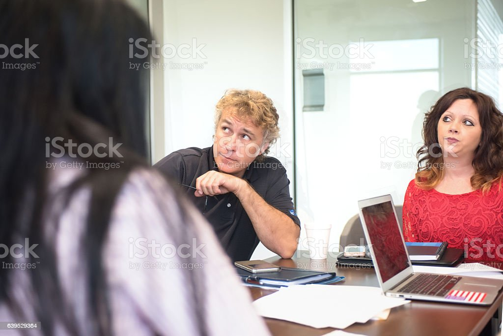 Showing Frustration During an Office Meeting stock photo