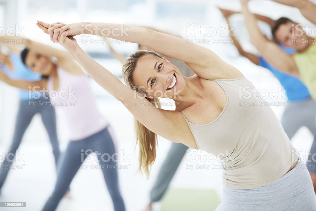 Showing her class the way to fitness stock photo