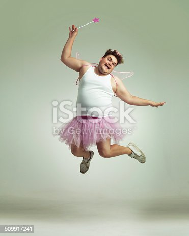 An overweight man comically dressed-up in a pink fairy costume