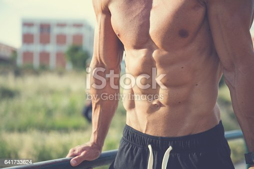 istock Showing his muscles 641733624