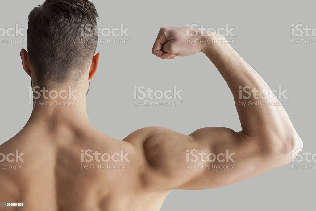 Mostrando su biceps perfecto. - Foto de stock de Adulto libre de derechos