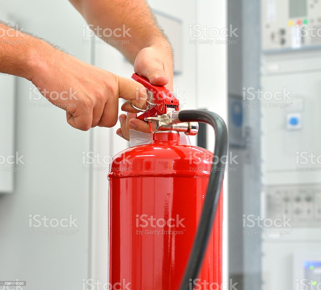 Showing how to Use Fire Extinguisher - Removing Safety Pin – Foto