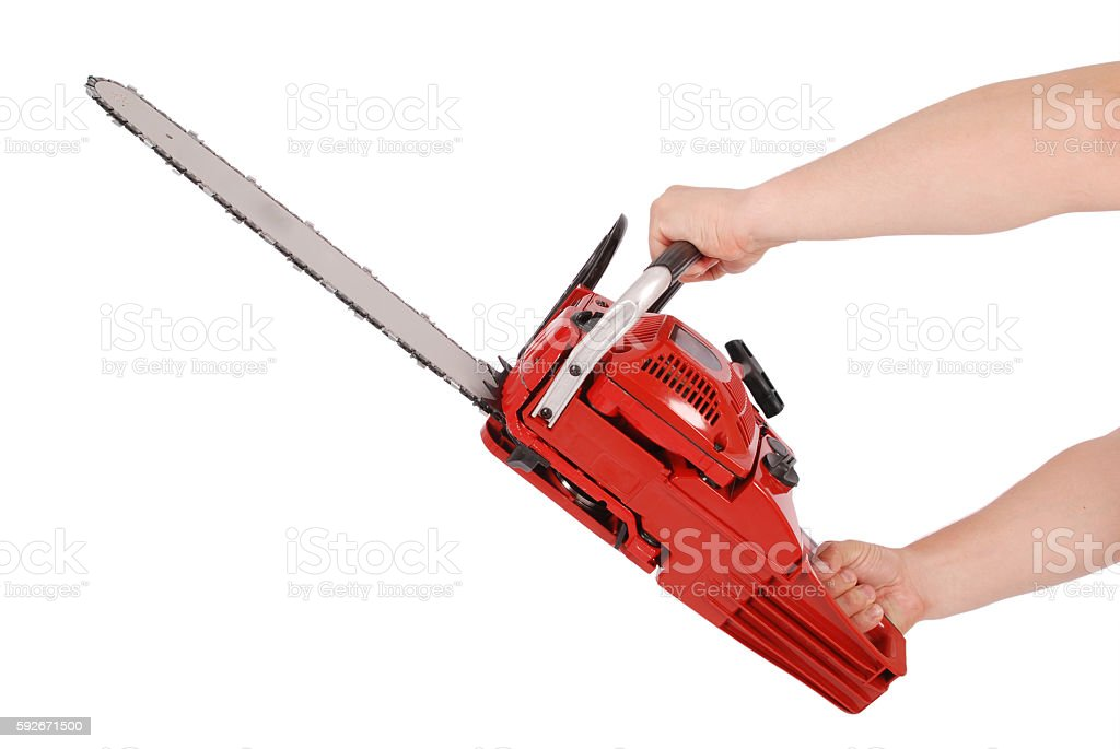 Showing how to work with chainsaw stock photo