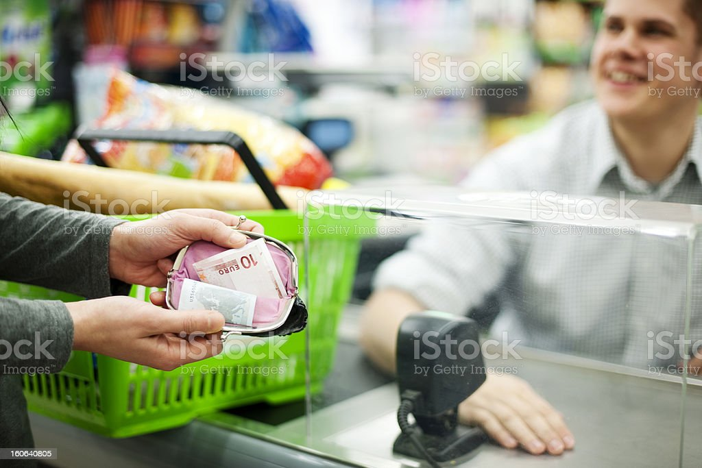 Showing money left on cash only supermarket stock photo