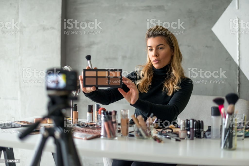 Showing new make up pallet Young woman making vlog about make up Adult Stock Photo