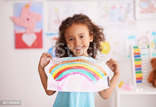 Shot of a little girl holding up a picture she painted of a rainbowhttp://195.154.178.81/DATA/i_collage/pi/shoots/783539.jpg