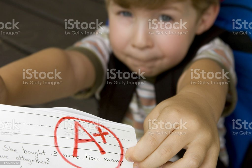 Showing Off His Good Grade royalty-free stock photo