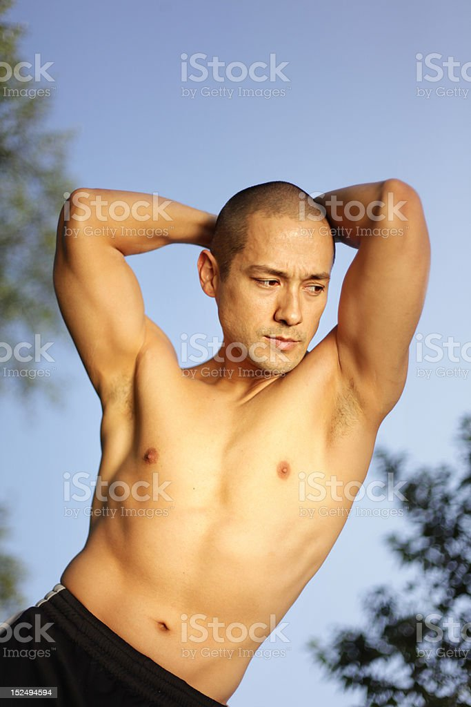 Showing off his physique stock photo