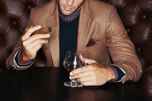 showing off his wealth - guy with cigar stockfoto's en -beelden