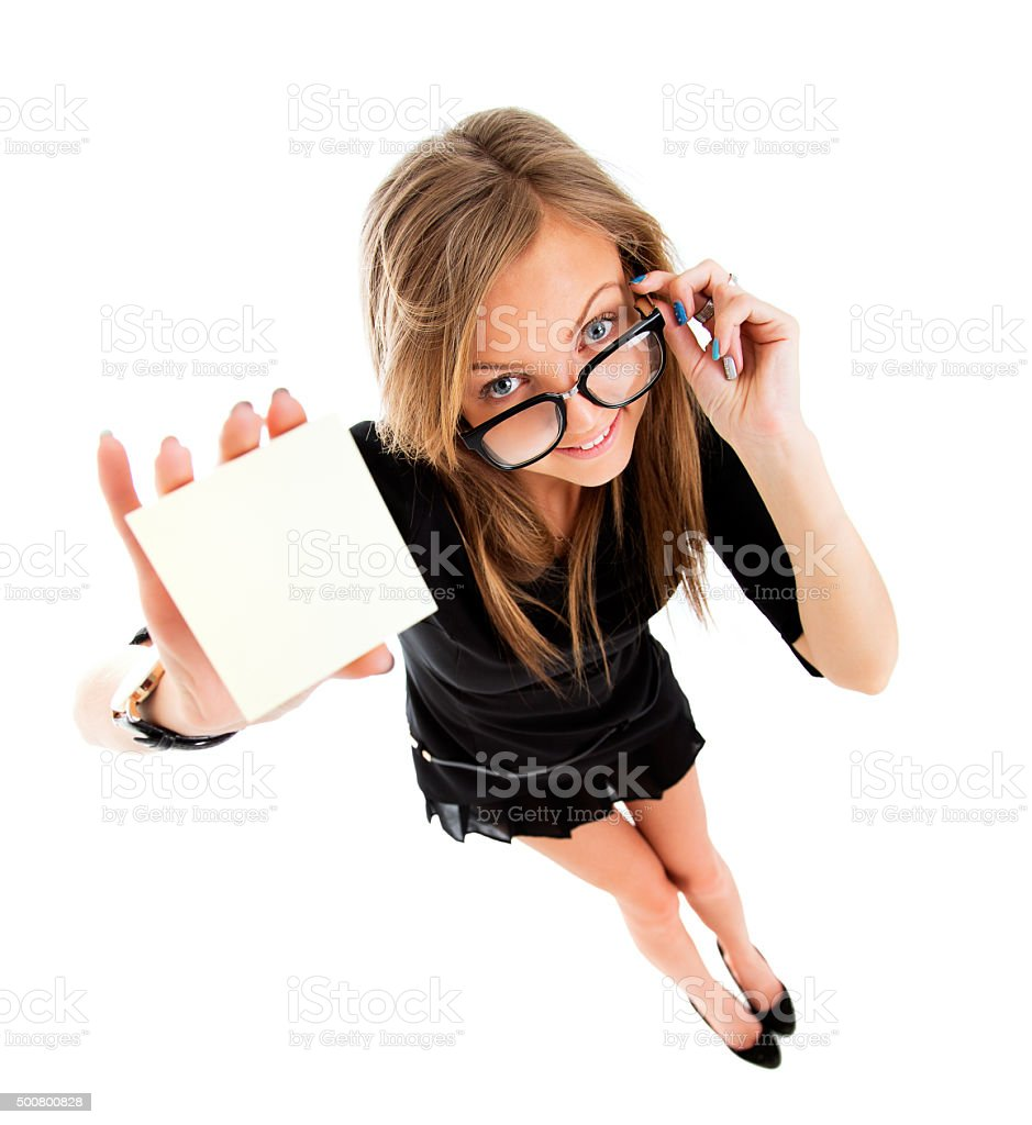 Showing sign - woman holding big business card / paper sign stock photo