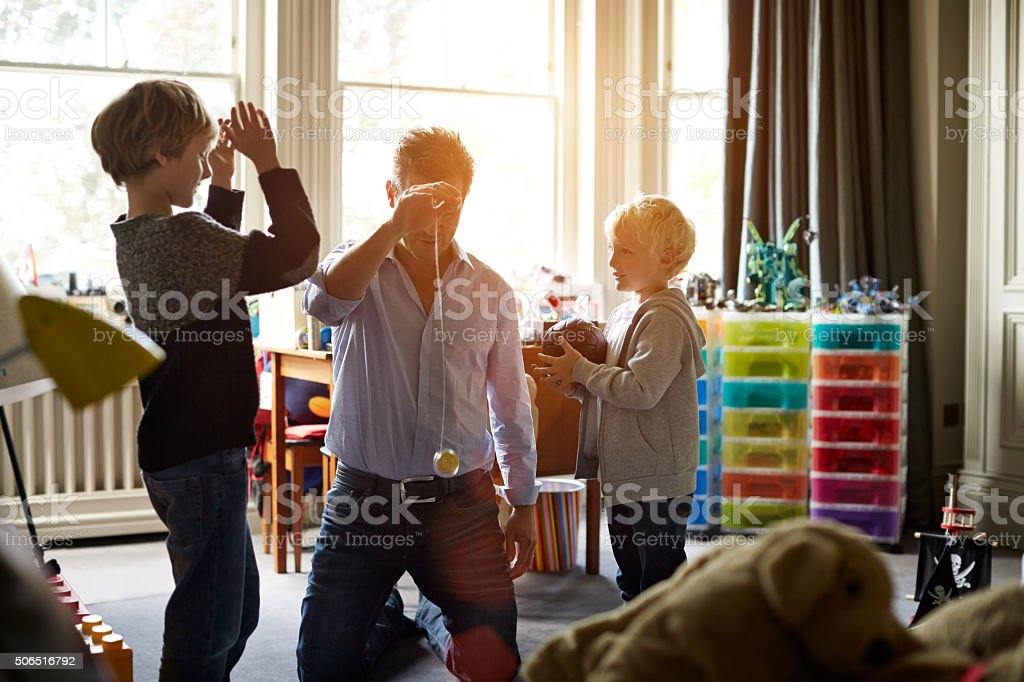 Showing the boys a trick or two! stock photo