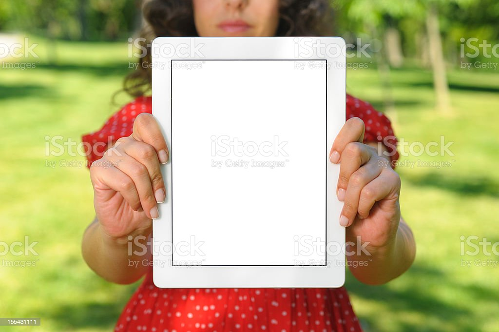 Showing white screen tablet pc in nature royalty-free stock photo