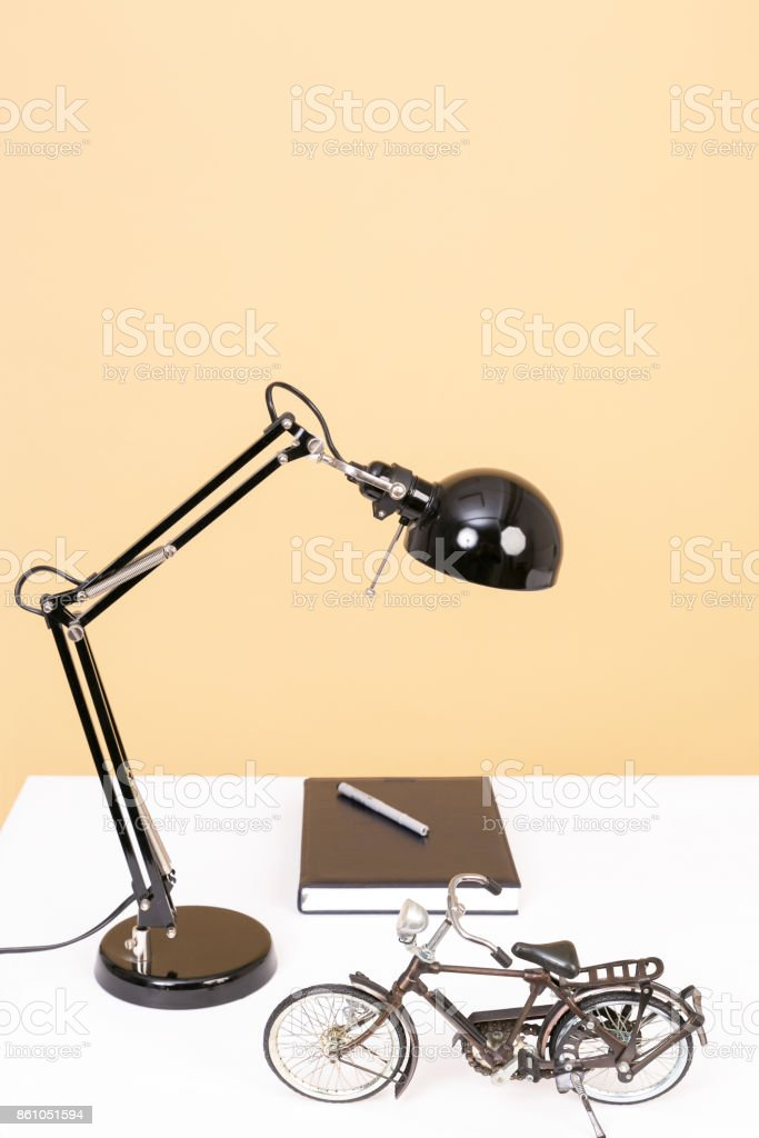 Showpiece and essentials on study table stock photo