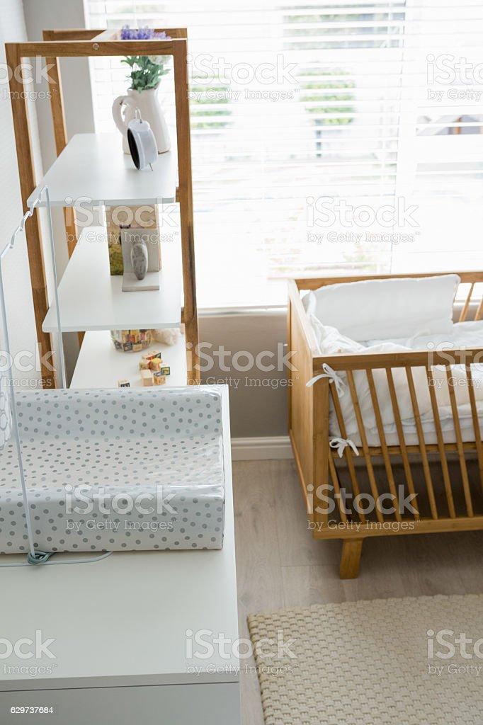 Showpiece on shelf with cradle stock photo