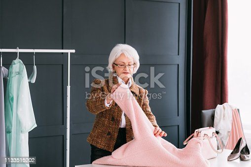 istock showroom vip senior business woman shopping trendy 1133515202