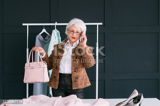 istock showroom vip senior business woman shopping trendy 1133957118