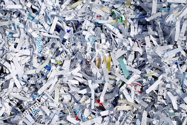 Shredded documents to protect confidential information stock photo