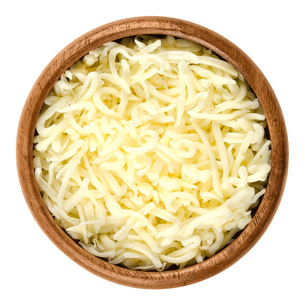 shredded mozzarella pizza cheese in wooden bowl over white - mozzarella foto e immagini stock