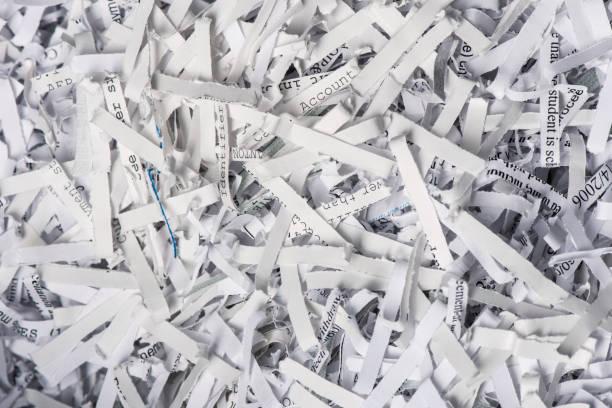 closeup de papel picado - robo de identidad fotografías e imágenes de stock