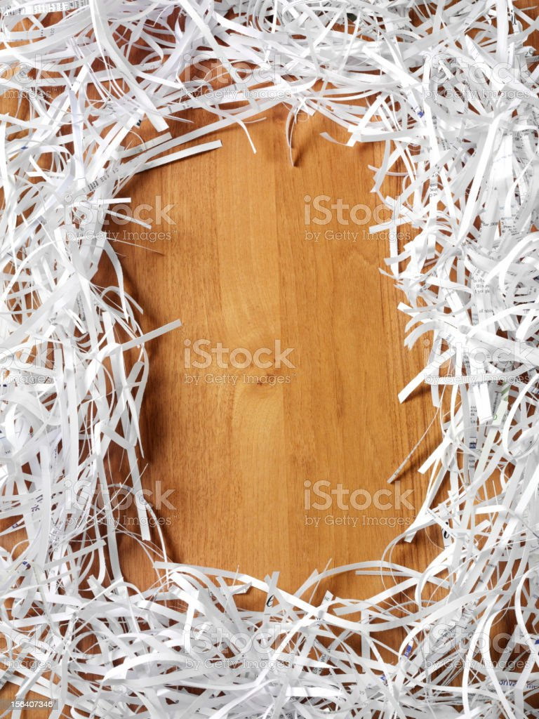 Shredded Paper on Wood royalty-free stock photo