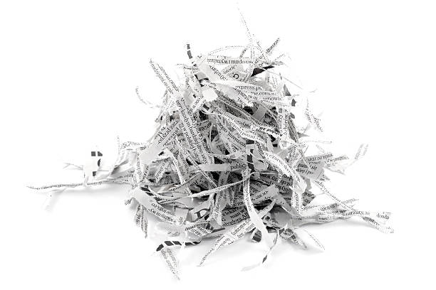 shredded paper strips from newspaper - shredded paper stock photos and pictures