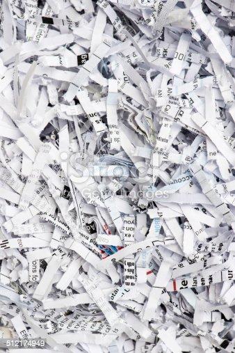 184640907istockphoto Shredded paper texture background 512174949