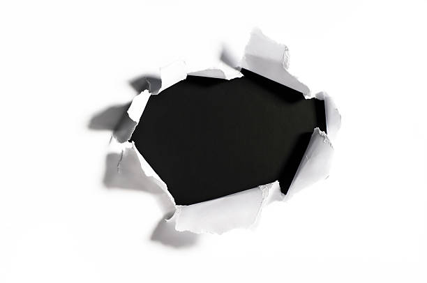 shredded paper with a hole stock photo