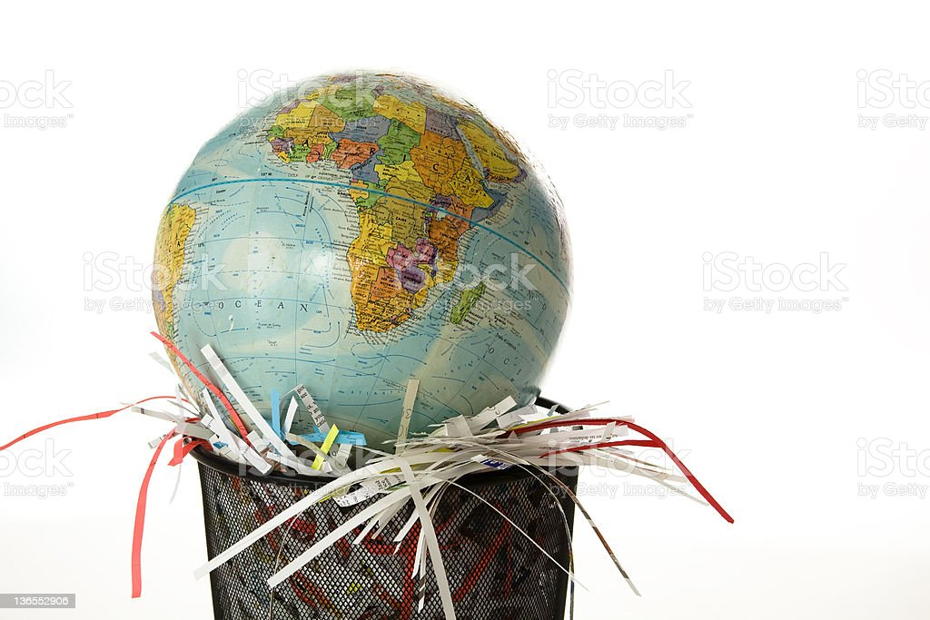 Shredded paper with globe in wastebasket royalty-free stock photo