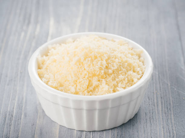 Shredded parmesan on gray wooden table. stock photo