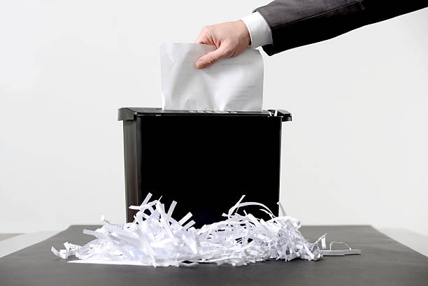 shredding a paper - shredded paper stock photos and pictures