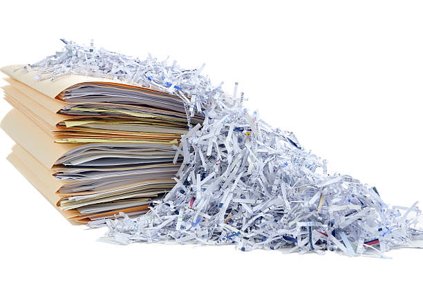 shredding documents - shredded paper stock photos and pictures