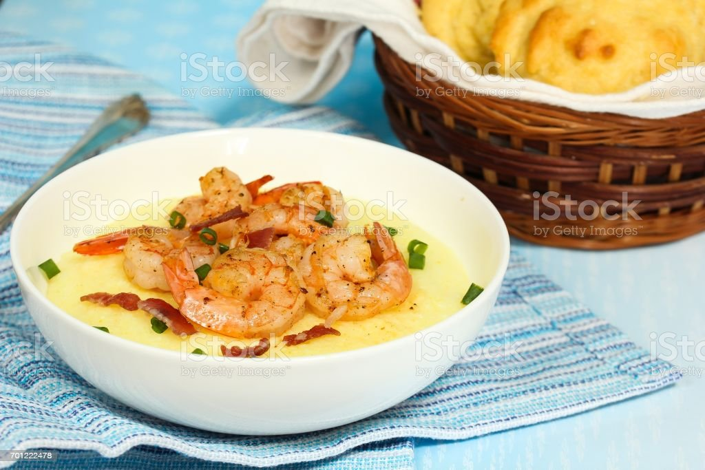Shrimp and grits  with corn muffins on side, selective focus stock photo