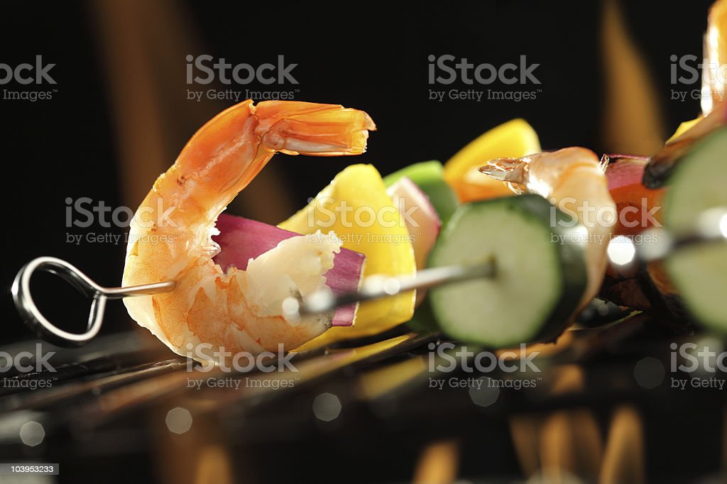 Shrimp and vegetable skewer on grill closeup royalty-free stock photo