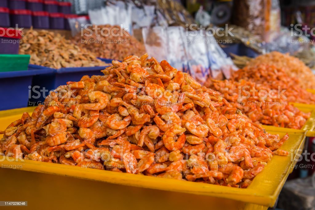 pile of dried shrimp. Seafood processing for sale at Seafood local...