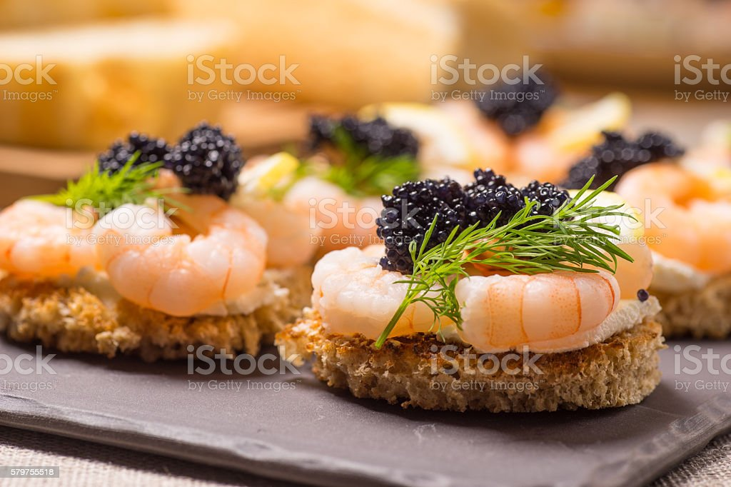 Shrimp Appetizer served on toasted bread stock photo
