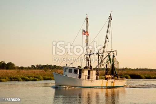 A Coastal Georgia shrimp boat returning to dock at the end of the day.
